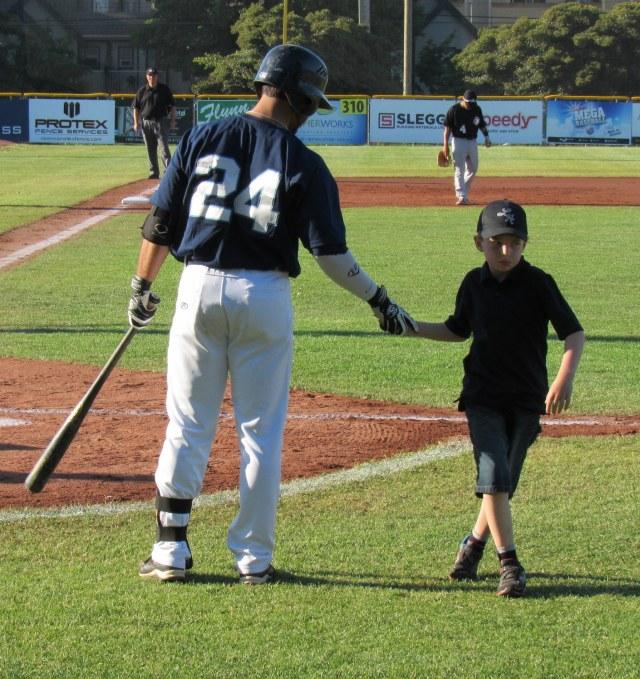 Leadoff batter Alex DeGoti and tonight's honorary batboy