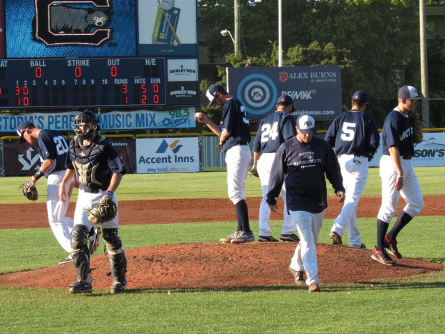 Coach Merritt leads an exodus from the mound after a conference