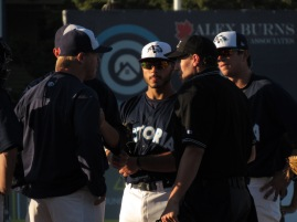 Merritt discusses the ump's strike zone with him prior to his ejection.